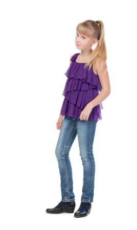 Young Girl Standing In Studio, isolated on white background photo