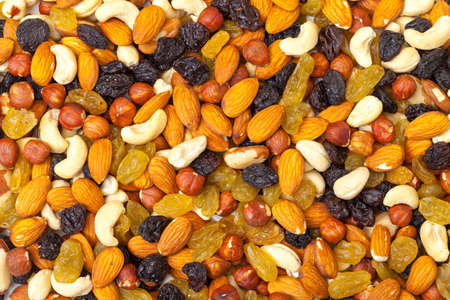 background of mixture of nuts and raisins, closeup photo