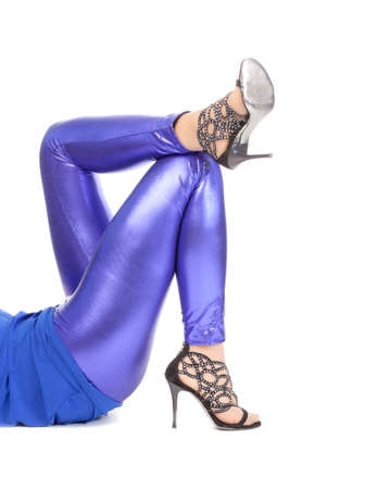 tantalising: Cropped view image of a womans sexy legs clad in shimmering blue leggins and stilettos Stock Photo