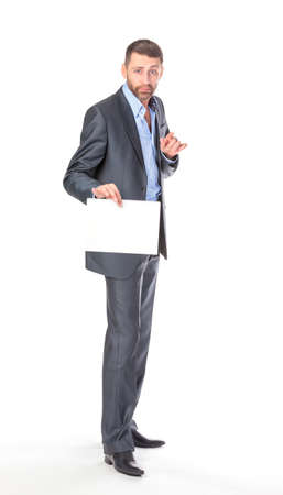 Full length portrait businessman showing an empty board to write, over white background photo