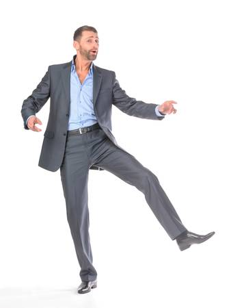 Full length portrait dancing businessman, over white background photo