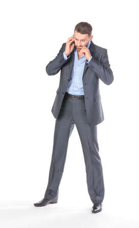 Full length portrait businessman with mobile phone, over white background photo