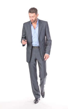 Full length portrait businessman with mobile phone, over white background