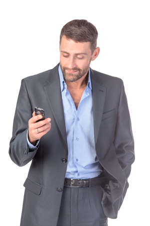 Portrait businessman with mobile phone, over white background photo