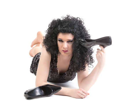 Portrait of drag queen lying on floor. Man dressed as Woman, isolated on white background photo