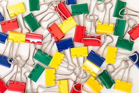 background of Multicolored Paper Clips, on white  photo