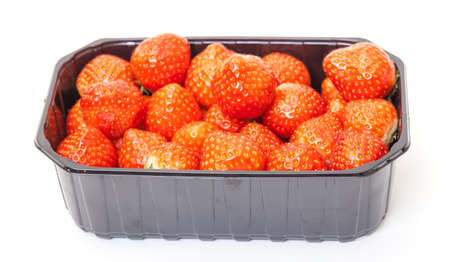 Fresh Strawberries in a Plastic Container on a white background. photo