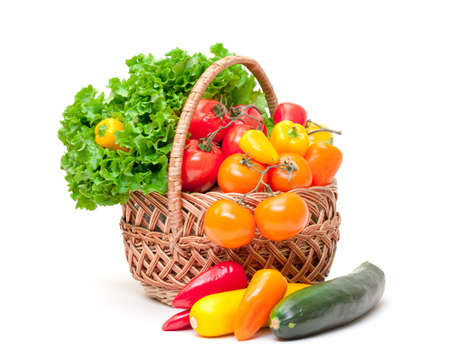 Mixed Fresh Vegetables in Basket, on white background photo