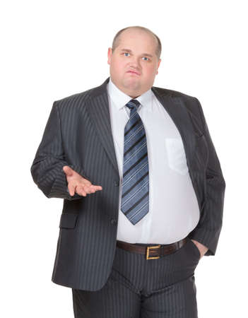 Obese businessman in a suit and tie standing facing the camera making a point with one hand in his pocket while gesturing with the other, isolated on white
