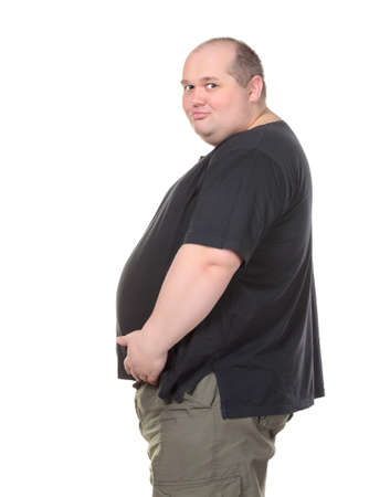 Fat Man Standing in Profile and Holding her Belly, on white background photo