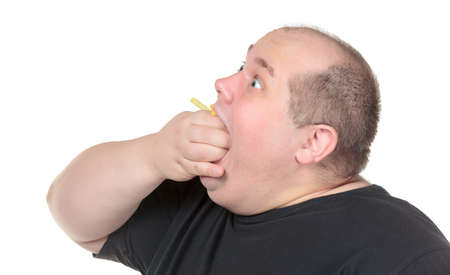 Fat Man Greedily Eating French Fries, on white background photo