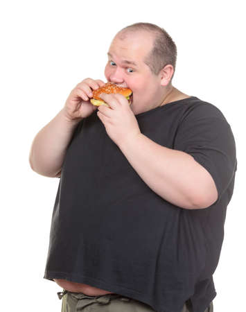 Fat Man Greedily Eating Hamburger, on white background photo