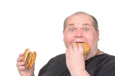 rotund: Fat Man Greedily Eating Hamburger, on white background