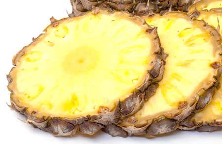 Slice Ripe Pineapple Fruit,  closeup on white background photo