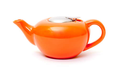 Orange Ceramic Teapot on white background photo