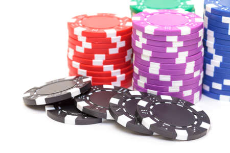 Stacks of Poker Chips, closeup on white background photo