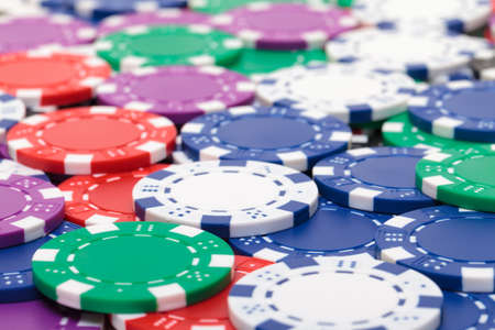 Background from of Multicolored Poker Chips, closeup photo