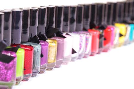 Group of bright nail polishes on white background photo