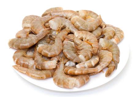 Raw headless prawns on white background Stock Photo