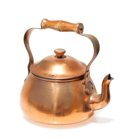 Antique copper teapot, closeup isolated on white background