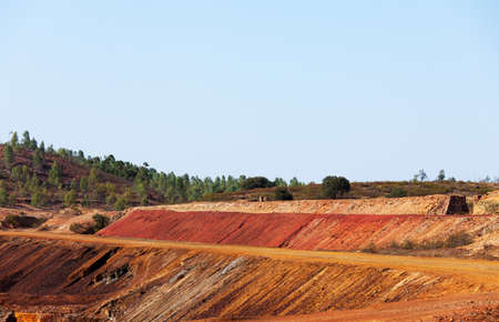 tailings: Copper mine tailings or refuse heaps remaining at a mine after the ore has been processed Stock Photo