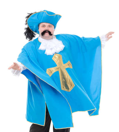 rotund: Cavalier gentleman in feathered cap and turquoise blue uniform of the cross, with over a rotund fat belly, isolated on white Stock Photo