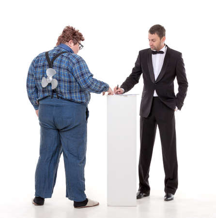 argumentative: Elegant man in a tuxedo and bow tie standing arguing with an overweight country yokel