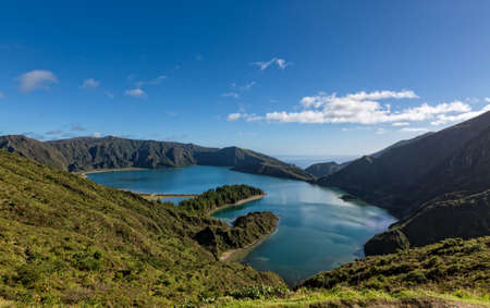 crater lake: Beautiful view of the Lake in Crater Volcano Covered with Forests, sunny day