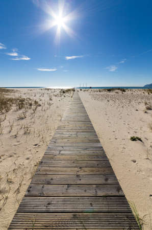 non urban scene: Wooden Walkway Leading to the Beach over Sand Dunes, sunny day