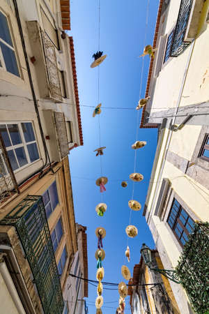 ''wide angle'': City Streets Decorated with Straw Hats, wide angle Stock Photo