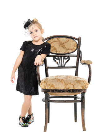 antique chair: Little Girl Standing near Antique Chair, on white background