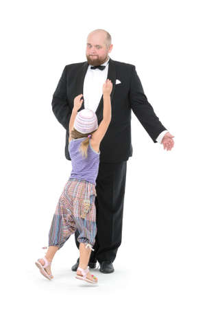 servant: Little Girl and Servant in Tuxedo Have Fun, on white background Stock Photo
