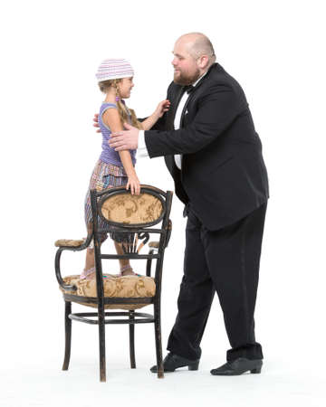 bald girl: Little Girl and Servant in Tuxedo Have Fun, on white background Stock Photo