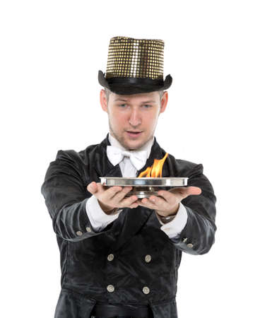 illusionist: Illusionist Shows Tricks with Fire, on white background