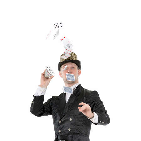 illusionist: Illusionist Shows Tricks with Playing Card, on white background Stock Photo