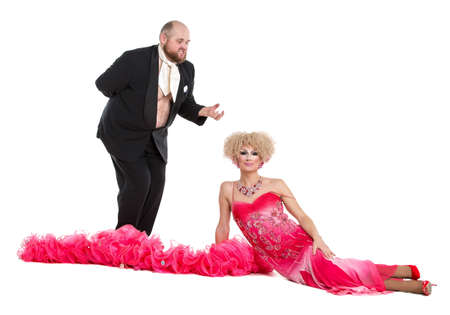 fatso: Eccentric Fat Man in a Tuxedo and Beautiful Lady in an Evening Dress Lying on Floor, drag queen artists on white background