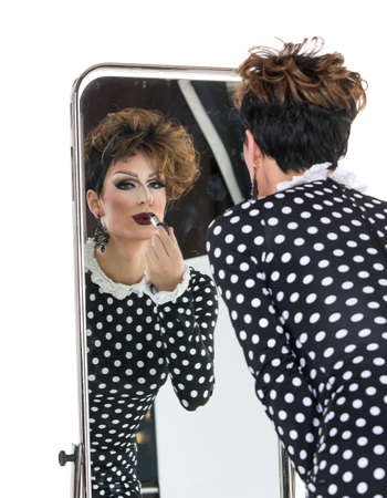 drag: Drag Queen use Lipstick near Mirror, on white background Stock Photo