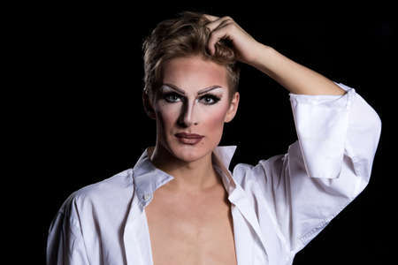sexy gay: Portrait of Artist with Makeup, on black background
