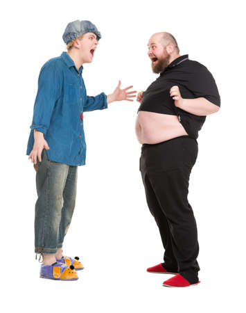 fatso: Actor Dressed as Fairy-Tale Hero Talking with Fatman, isolated on white background Stock Photo