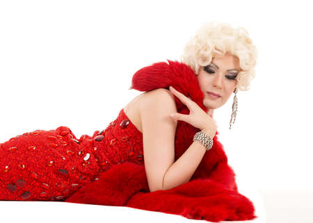 travesty: Drag Queen in Red Dress with Fur Lying on the Floor, on white background