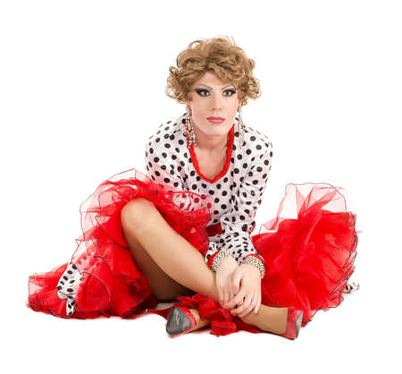 travesty: Portrait Drag Queen in Woman Dress Sitting on Floor, on white background