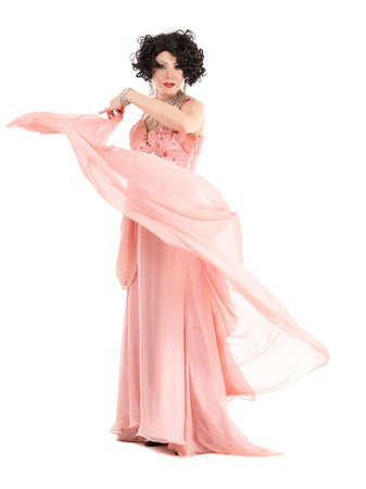 travesty: Portrait Drag Queen in Pink Evening Dress Performing, on white background