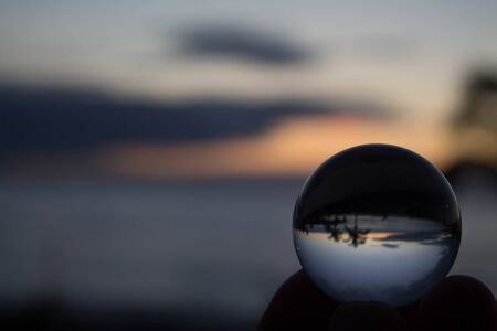 Nice landscape behind a crystal ball
