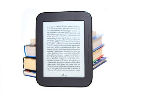 Electronic book (e-book) and stack of color books isolated on white background Фото со стока