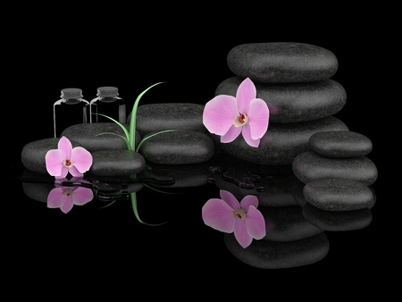 Spa treatment concept. Zen stones, orchid and bottles of essential oil Stock Photo