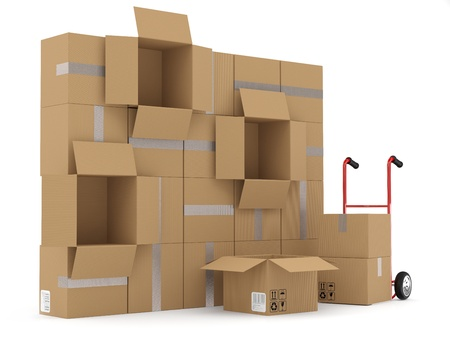 stockpiling: Almac�n concepto. Cajas de cart�n yh carretilla de mano Foto de archivo