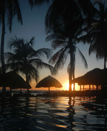 curacao: Silhouette of Curacao beach and pool Stock Photo