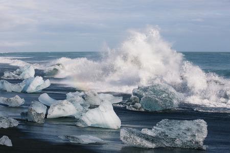 ice blocks: ice blocks on black sand beach