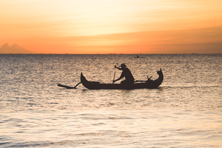 indonesia culture: Fisherman on boat in Jimbaran, Indonesia Stock Photo