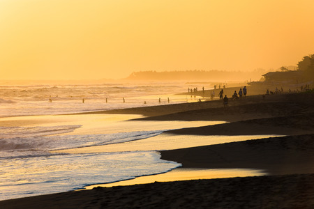 indian ocean: Silhouettes of people at sunset on Kuta beach in Bali, Indonesia
